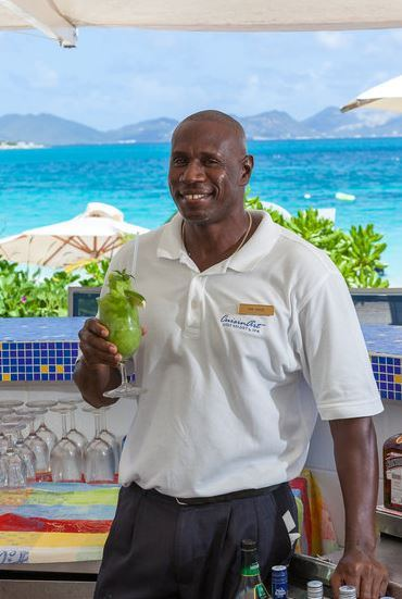 Sam with one of his signature frozen Mojitos made with fresh mint.